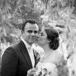 Bride kisses groom - Wedding photograph