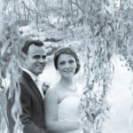 Bride and groom under weeping willow - Wedding photograph