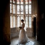 bride in oriel window at Athelhampton House