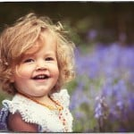 Child portrait photo in bluebell woods Dorset