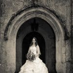 Bride in doorway at Athelhampton House