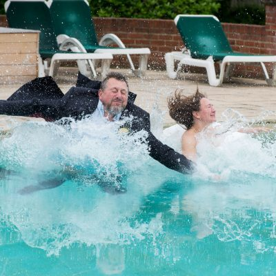 bride and groom in swimming pool, balmer lawn hotel, new forest