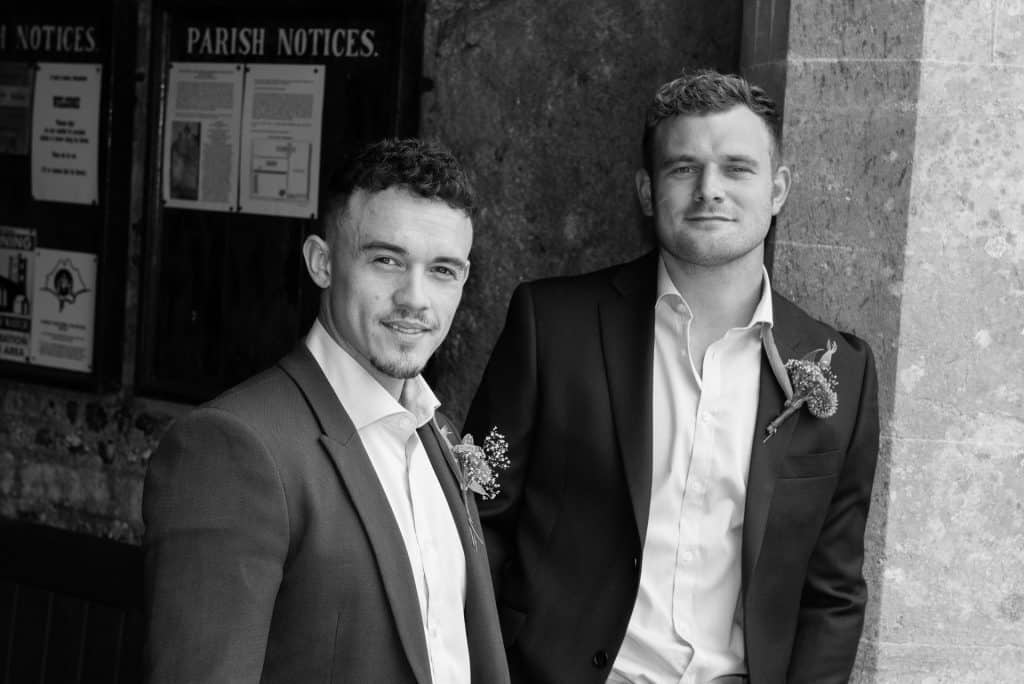 Groom and best man at St Mary the Virgin Church, Piddlehinton